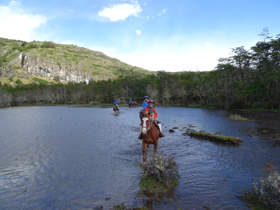 """yes, slogging back through the muddy river - you could almost hear the horses thinking 'really?"""" another tourist and I have to slog through this water when there is a perfectly good trail 10 feet away..."""""""