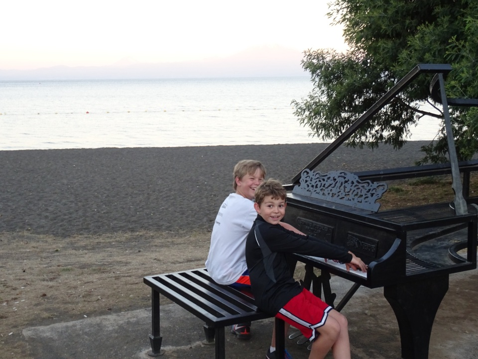 a metal piano near the beach.