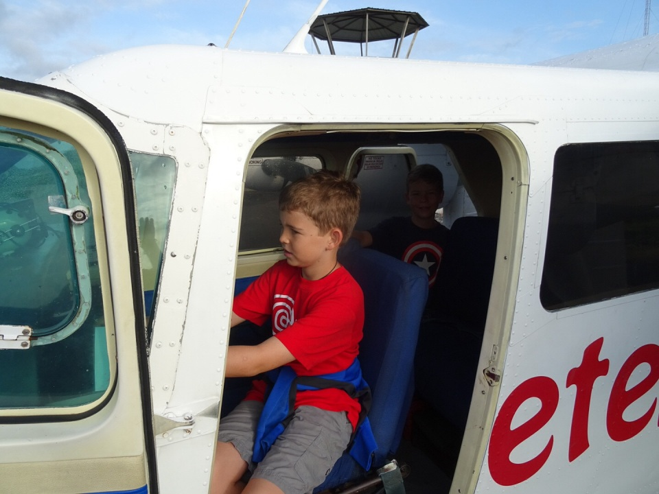 the boys were more than happy to go in the small plane.